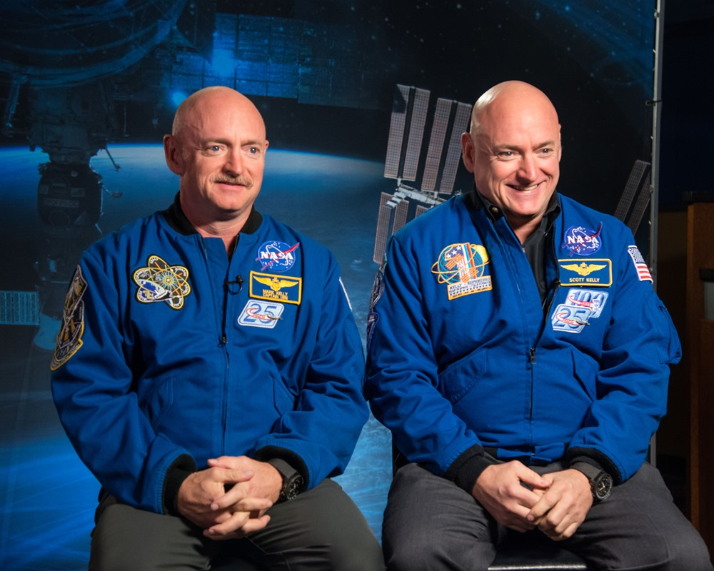 Expedition 45/46 Commander, Astronaut Scott Kelly along with his brother, former Astronaut Mark Kelly speak to news media outlets about Scott Kelly's 1-year mission aboard the International Space Station. Photo Date: January 19, 2015. Location: Building 2. Photographer: Robert Markowitz